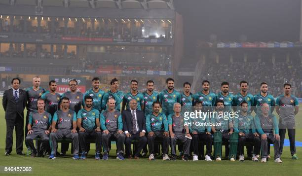Pakistani cricketers pose for a photograph along with Chairman Pakistan Cricket Board Najam Sethi at the Gaddafi Cricket Stadium in Lahore on...