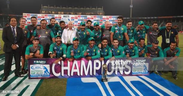 Pakistani cricketers pose for a photograph with trophy after winning the third and final Twenty20 International match against World XI at the Gaddafi...