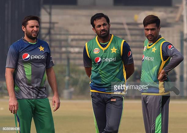 Pakistani cricketers Shahid Afridi Wahab Riaz and Mohammad Amir take part in a team practice session in Lahore on January 6 2016 Pakistans cricket...