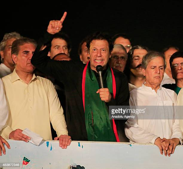 Pakistani cricketerturned politician and chairman of the Pakistan TehreekeInsaf political party Imran Khan speaks during an antigovernment rally at...