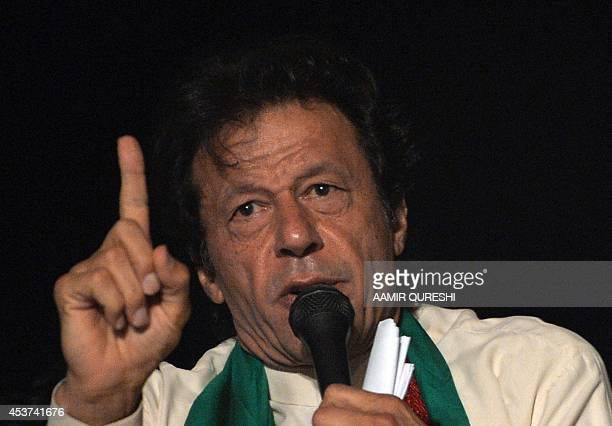 Pakistani cricketerturned politician Imran Khan speaks to supporters during a rally after a populist cleric issued a 48hour ultimatum demanding the...