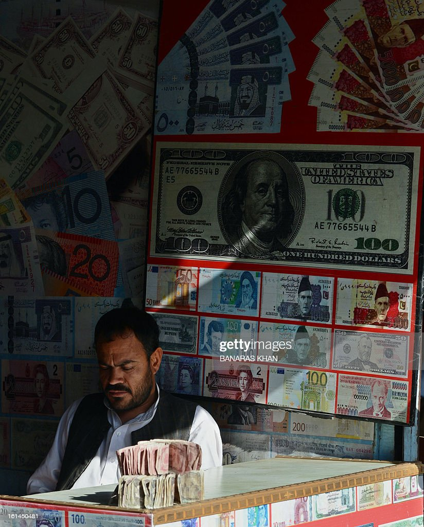 A Pakistani currency dealer waits for customers at a currency exchange shop in Quetta on February 11, 2013. The Pakistani rupee on Monday sank to an all-time low against the US dollar over forex reserve fears as the country repayed $146 million to the International Monetary Fund. AFP PHOTO/Banaras KHAN