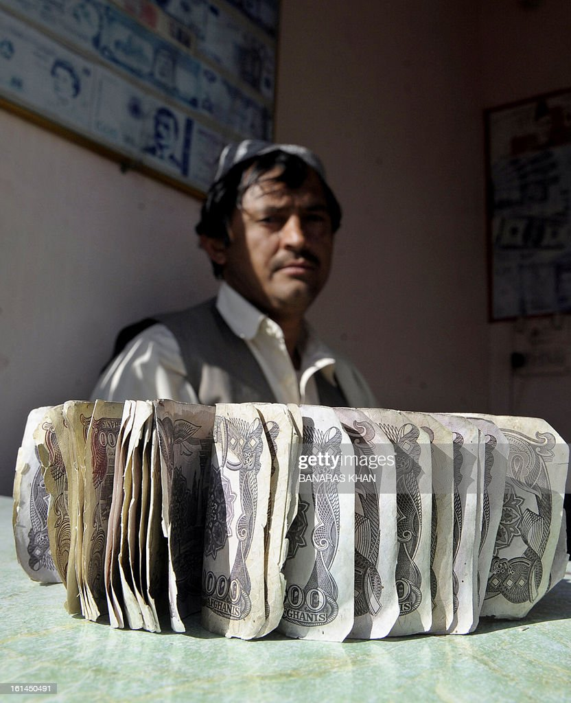 A Pakistani currency dealer waits for customers at a foreign exchange shop in Quetta on February 11, 2013. The Pakistani rupee on Monday sank to an all-time low against the US dollar over forex reserve fears as the country repayed $146 million to the International Monetary Fund. AFP PHOTO/Banaras KHAN