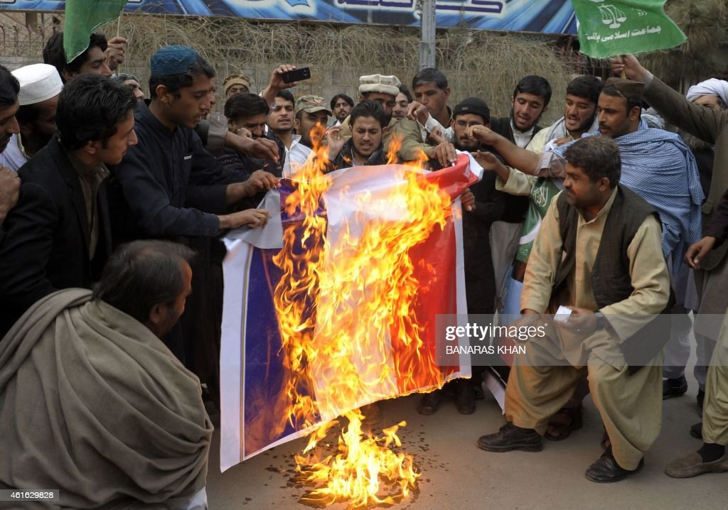 Pakistani demonstrators burn a French flag during a protest against the printing of satirical sketches of the Prophet Muhammad by French magazine Charlie Hebdo in Quetta on January 16, 2014. At least three people were injured in clashes between anti-Charlie Hebdo protesters and police outside the French consulate in Pakistan's Karachi, officials said. The protest by the student wing of the Jamaat-e-Islami religious party was one of several that Islamist groups staged across the country after Friday prayers against the depiction of the Prophet <a gi-track='captionPersonalityLinkClicked' href=/galleries/search?phrase=Mohammed&family=editorial&specificpeople=3955327 ng-click='$event.stopPropagation()'>Mohammed</a> by the French satirical weekly. AFP PHOTO/ Banaras Khan