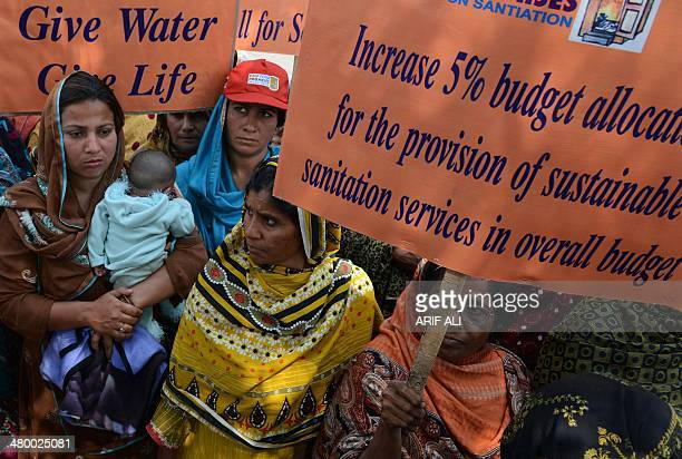Pakistani demonstrators carry posters as they take part in a march to mark World Water Day in Lahore on March 22 2014 International World Water Day...