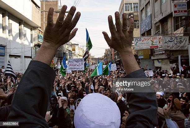 Pakistani demonstrators raise their hands in support of 'Jihad' or holy war during an antiAmerican protest January 20 2006 in Peshawar Pakistan...