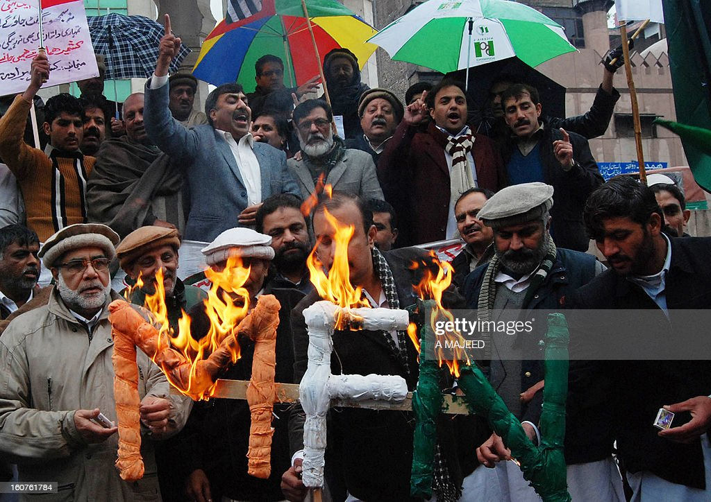 Pakistani demonstrators set fire the sign to mark Kashmir Solidarity day in Peshawar on February 5, 2013. Pakistan observed Kashmir Solidarity Day on February 5, to denounce Indian rule in the disputed Himalayan region claimed in whole by both countries. AFP PHOTO/A Majeed