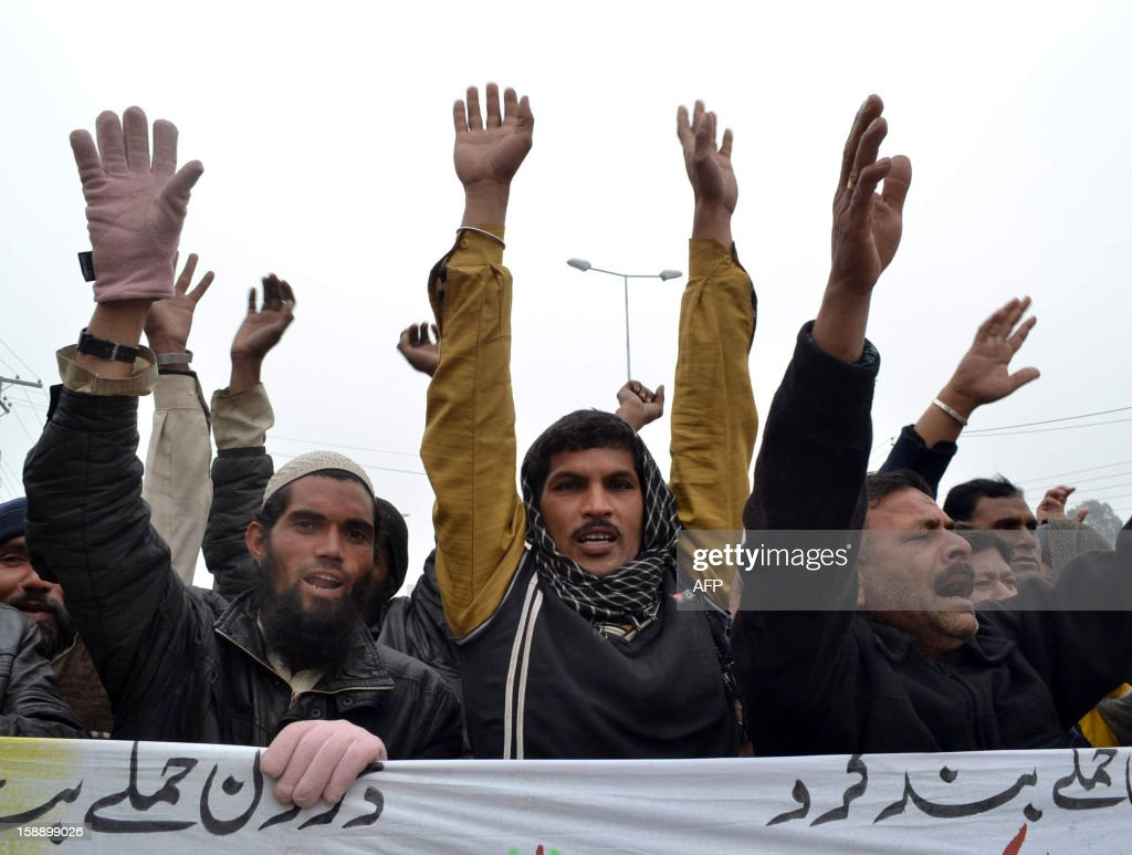 Pakistani demonstrators shout anti-US slogans during a protest in Multan on January 3, 2013, against the drone attacks in Pakistan's tribal areas. Pakistani warlord Mullah Nazir, who sent men to fight NATO troops in Afghanistan, was killed in a US drone strike in Pakistan along with five loyalists, local security officials said. He was the main militant commander in South Waziristan, part of Pakistan's northwestern tribal belt considered a base for Al-Qaeda, the Taliban and other Islamist militants, and a powerful elder in the Wazir tribe. AFP PHOTO/S.S MIRZA