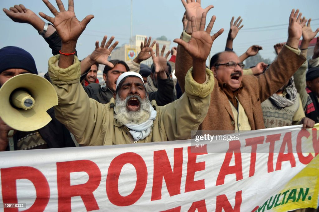 Pakistani demonstrators shout anti-US slogans during a protest in Multan on January 8, 2013, against the drone attacks in Pakistan's tribal areas. At least eight militants were killed and four others wounded on January 8 when US drones fired missiles at militant compounds in a lawless Pakistani tribal area, security officials said. AFP PHOTO/S.S MIRZA