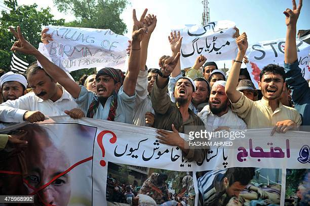 Pakistani demonstrators shout slogans during a protest in support of Rohingya Muslims at a rally in Peshawar on June 5 2015 Myanmar refuses to...