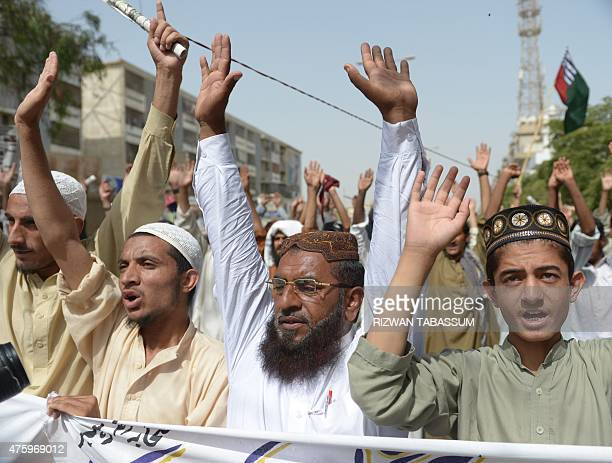 Pakistani demonstrators shout slogans during a protest in support of Rohingya Muslims at a rally in Karachi on June 5 2015 Myanmar refuses to...