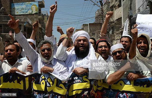 Pakistani demonstrators shout slogans during a protest in support of Rohingya Muslims at a rally in Peshawar on June 6 2015 Myanmar refuses to...