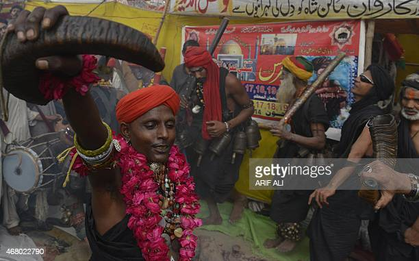 Pakistani devotees dance at the shrine of Sufi saint Hazrat Shah Hussain popularly known as Madhu Lal Hussain in Lahore on March 29 2015 The annual...