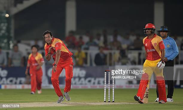 Pakistani director and bowling coach of Islamabad United Wasim Akram delivers the ball during an exhibition match at Rawalpindi Cricket stadium in...