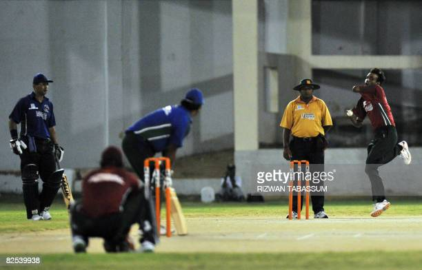 Pakistani disabled cricketer Mohammad Amjad of Multan delivers a ball to Rawalpindi batsman Amjad Ali during the final of the firstever National...