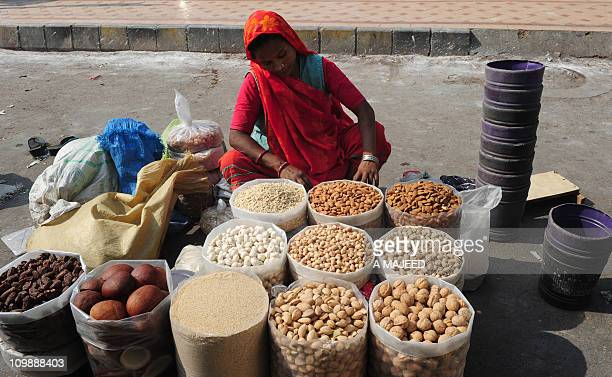 A Pakistani dry fruit vendor waits for customers on the roadside in Karachi on March 5 2011 Pakistan said it would increase petrol prices by about...