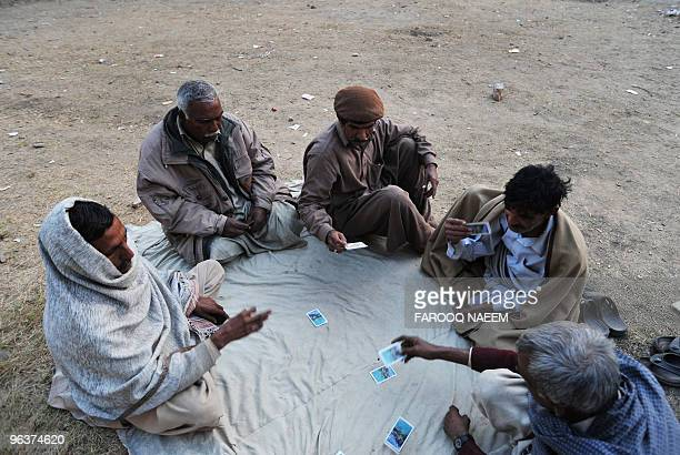 Pakistani elderly men play cards in a slum area of Islamabad on February 1 2010 Longer lifespans falling fertility rates and growing ranks of elderly...