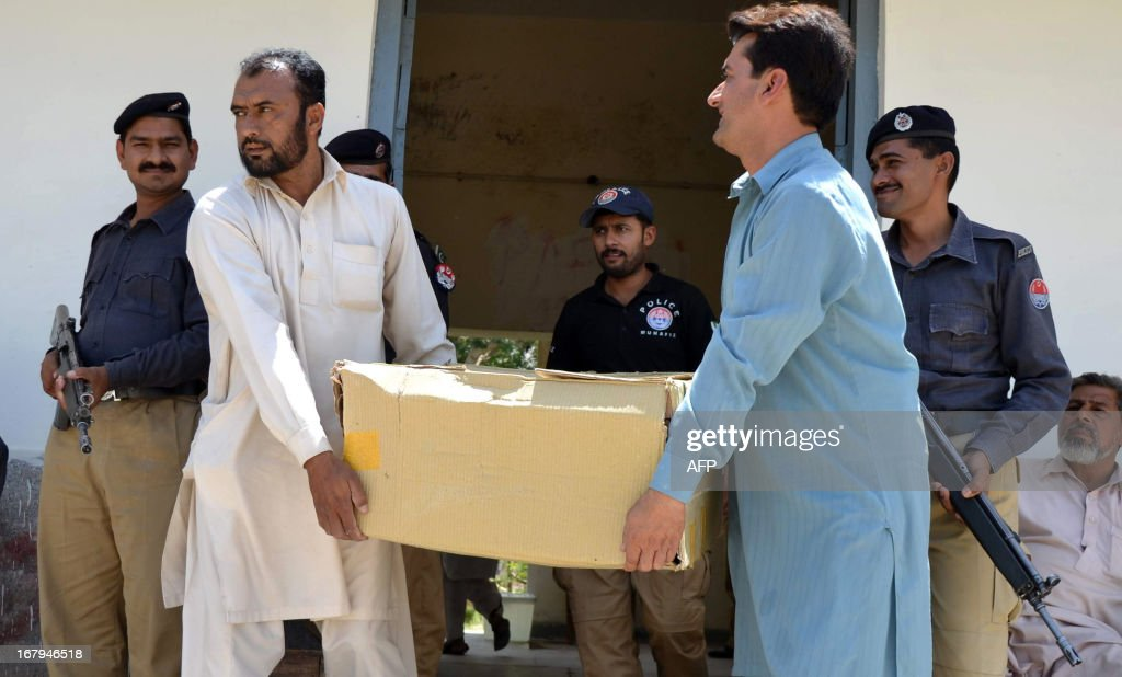 Pakistani election officials carry electoral materials towards a truck before being transported to polling stations for the forthcoming parliamentary elections, in Multan on May 3, 2013. Pakistan will deploy more than 600,000 security personnel during next week's general election to guard against Taliban attacks that have marred campaigning. The May 11 polls will mark the first time that a civilian government has completed a full five-year term and handed over to an elected successor, in a country ruled by the military for half its 66-year history.