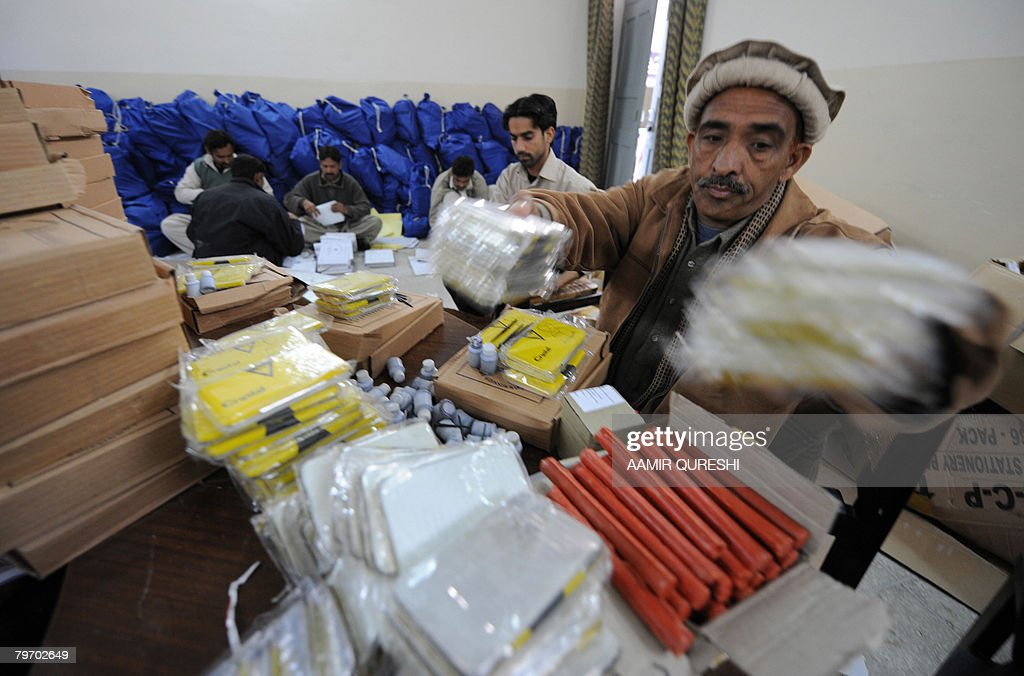 Pakistani election workers pack election material at the premises of the city court in Rawalpindi on February 11 2008 A suicide bomber killed at...