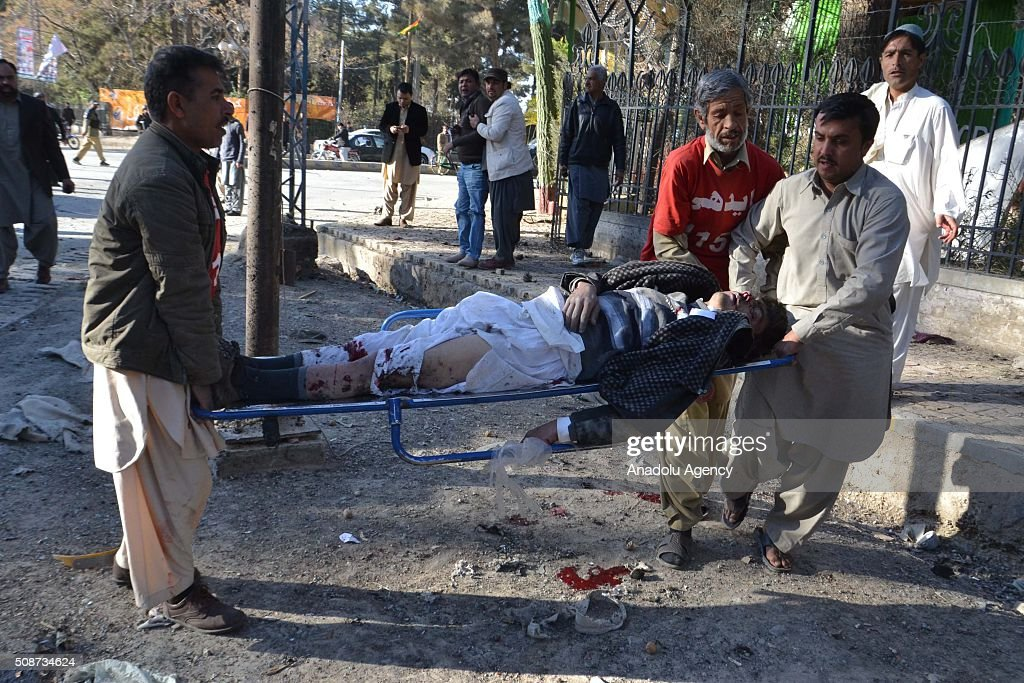 Pakistani emergency workers carry a body at the site of a suicide attack in Quetta, Pakistan, on February 6, 2016. At least nince people were killed and several others wounded in a suicide attack near the premises of the heavily guarded Quetta district courts on Saturday.
