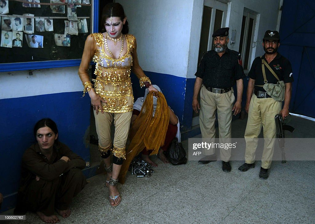 Pakistani eunuch Kashif (L) sits in police station in Peshawar on May 25, 2010. Police arrested Malik Iqbal, a man for marrying Kashif also known as Rani in northwestern Pakistan. Under Pakistani law gay marriage or a man�s marriage to a eunuch is a criminal offence and carries a maximum 10-year prison sentence.