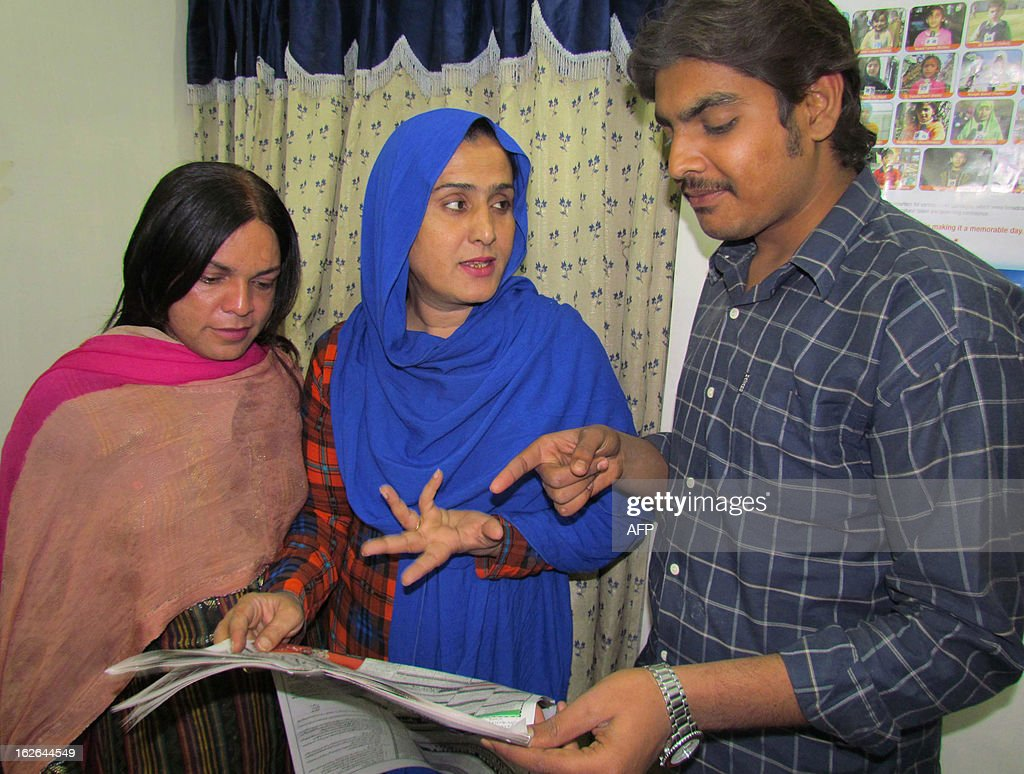 Pakistani eunuch Sanam Fakir (C), 32, talks to his election campaign staff ahead of general elections in Sukkur, about 800 kilometres (500 miles) southwest of Islamabad, on February 25, 2013. A member of Pakistan's transgender community is to contest upcoming general elections on a ticket of equal rights, saying the community has more to offer than begging or dancing at weddings. AFP PHOTO/Shahid ALI