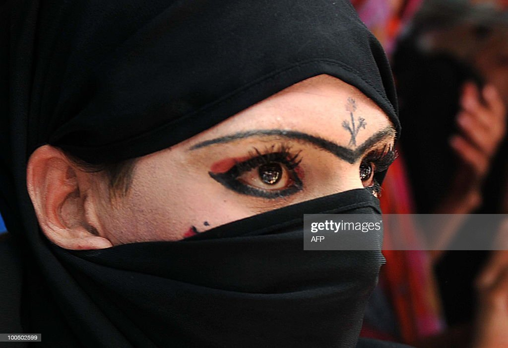 A Pakistani eunuch who was arrested in eunuch wedding ceremony, sits in a police station in Peshawar on May 25, 2010. Police arrested Malik Iqbal, a man for marrying a eunuch in northwestern Pakistan. Under Pakistani law gay marriage or a man�s marriage to a eunuch is a criminal offence and carries a maximum 10-year prison sentence.
