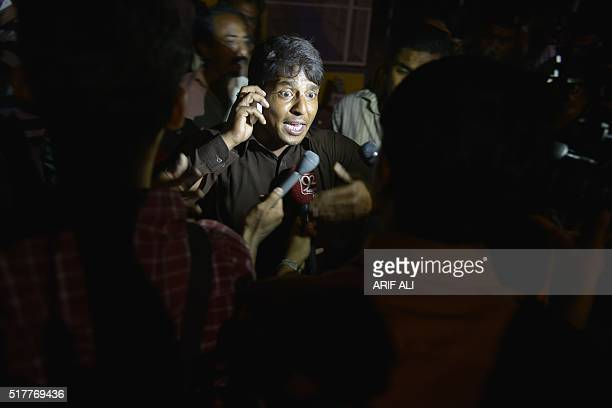 A Pakistani eye witness talks with media representatives at a bomb blast site in Lahore on March 27 2016 At least 25 people were killed and dozens...