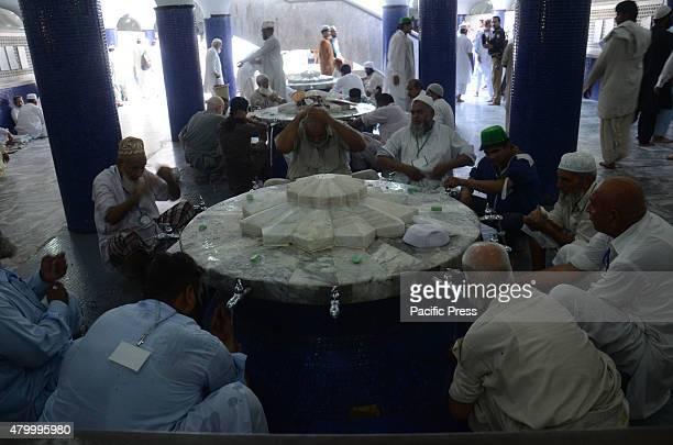 Pakistani Faithful Muslims at Data Darbar and Badshahi Masjid are taking part in Itekaf during the start of last Ashra of Holy Fasting Month of...