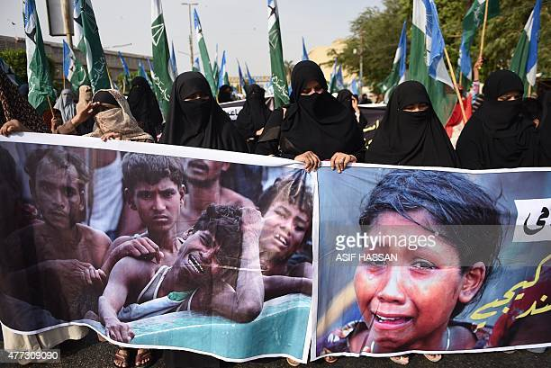 Pakistani female demonstrators carry a banner as they march during a protest in support of Rohingya Muslims at a rally in Karachi on June 16 2015...