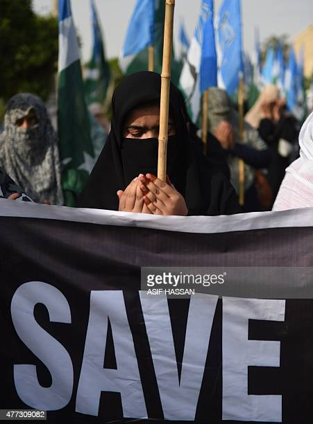Pakistani female demonstrators pray during a protest in support of Rohingya Muslims at a rally in Karachi on June 16 2015 Myanmar refuses to...