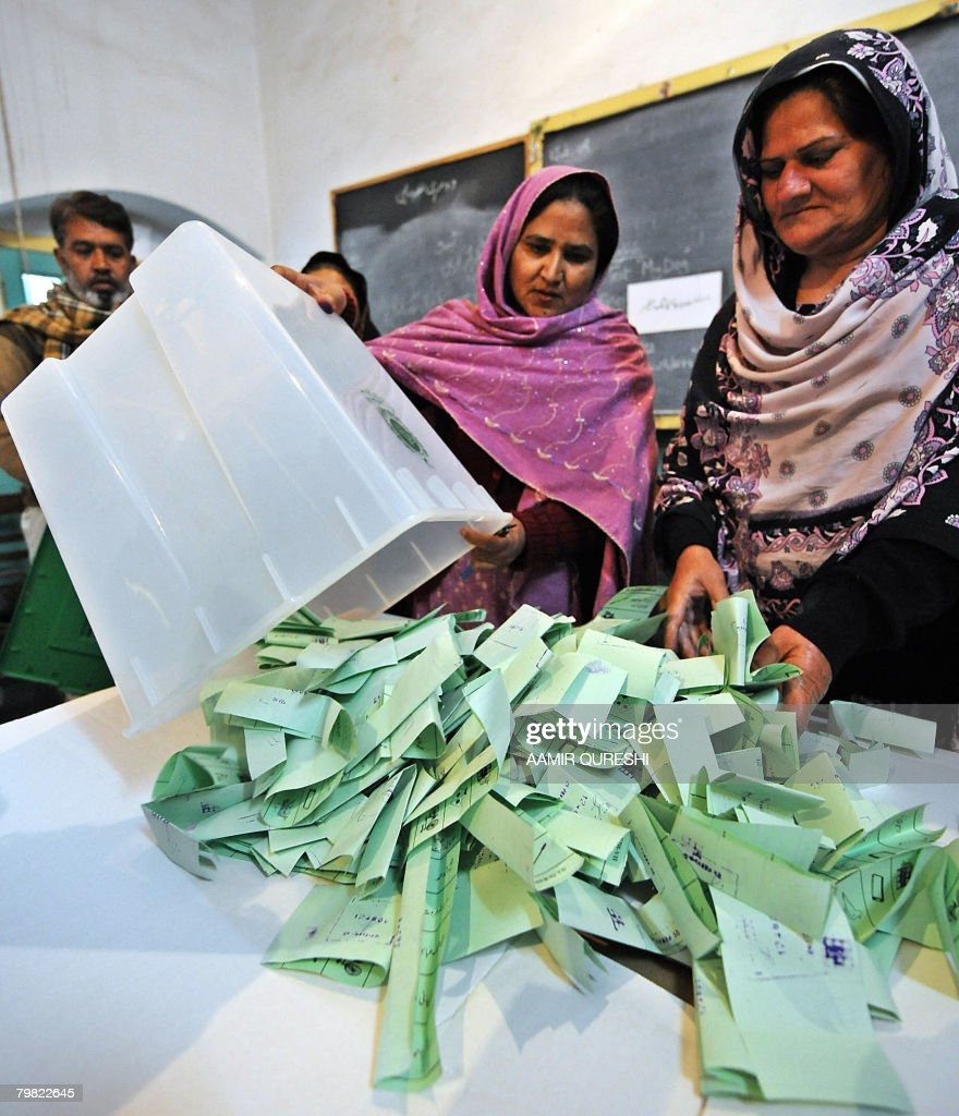Pakistani female electoral officials empty a ballot box at the end of the polling in Rawalpindi on February 18 2008 Polls closed in Pakistan in a...
