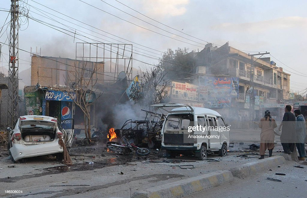 Pakistani firefighters extinguish the burning cars at the site of a bomb blast at car repair market on October 30, 2013 in Quetta, Pakistan. A bomb exploded on Wednesday in a crowded car repair market in the central part of Quetta, capital city of the southwestern Baluchistan province, killing at least four people and injuring 14 others.