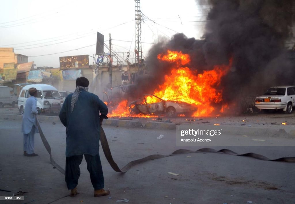 Pakistani firefighters try to extinguish the burning cars at the site of a bomb blast at a car repair market on October 30, 2013 in Quetta, Pakistan. A bomb exploded on Wednesday in a crowded car repair market in the central part of Quetta, capital city of the southwestern Baluchistan province, killing at least four people and injuring 14 others.