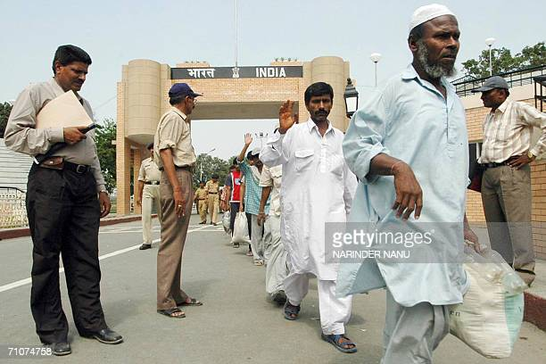 Pakistani fishermen wave before crossing the IndiaPakistan border at the Wagah Border Post 29 May 2006 after their release from Indian jail Fiftynine...