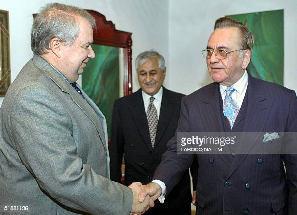 Pakistani Foreign Minister Khurshid Kasuri shakes hands with Russian Deputy Foreign Minister Sergey Kislyak prior to a meeting in Islamabad 20...