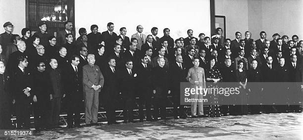 Pakistani Foreign Minister Zulfikar Ali Bhutto and members of his delegation stand with Chinese Premiere Zhou Enlai and members of his delegation in...