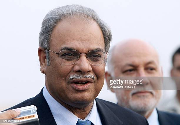Pakistani Foreign Secretary Riaz Mohammad Khan addresses media representatives as Pakistani High Commissioner to India Aziz Ahmed Khan looks on upon...