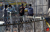 Pakistani forensics experts investigate the site of the March 27 suicide bombing in Lahore on March 28 2016 The toll from a suicide blast in...