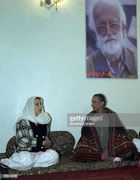 Pakistani former prime minister Benazir Bhutto talks with Talal Bugti son of slain rebel tribal chief Nawab Akbar Bugti as Bugti son during a visit...