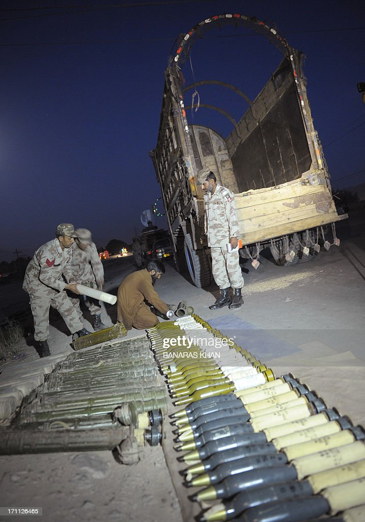 Pakistani Frontier Corps (FC) arrange seized rockets at a check point in Quetta on June 22, 2013. Local chief of paramilitary Frontier Corps (FC) colonel Maqbool Ahmad told AFP that 'We intercepted the truck, which was coming from the border town of Chaman on an intelligence tip off and arrested the driver after recovering 50 rockets with fuses'. AFP PHOTO/Banaras KHAN