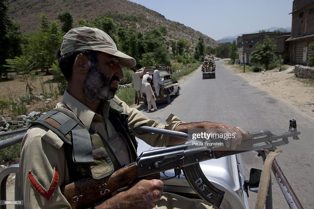 Pakistani Frontier Corps soldier patrols the streets via a truck during a media visit to the area June 23 2009 in Buner district Pakistan Over 19...