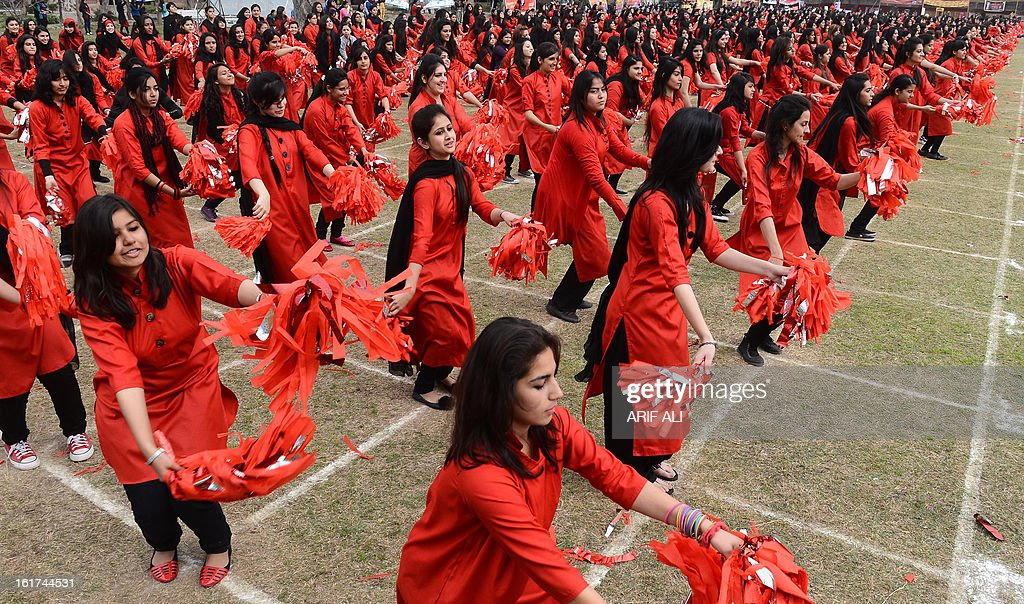 Pakistani girls perform during the annual sports day in Kinnaird college in Lahore on February 15, 2013, on its 100th anniversary. Education is a major challenge in nuclear-armed Pakistan, where the United Nations Children's Fund (UNICEF) says public spending on education is less than 2.5 percent of GDP. AFP PHOTO/Arif ALI