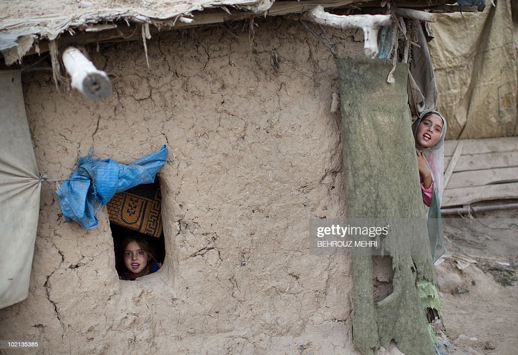 Pakistani girls rlook on in a house in a slum area in Islamabad on June 15, 2010. Pakistan approached the International Monetary Fund in 2008 and has secured a 11.3 billion USD standby loan in an effort to contain inflation and cope with a rapid depletion of reserves that were barely enough to cover nine weeks of import bills.