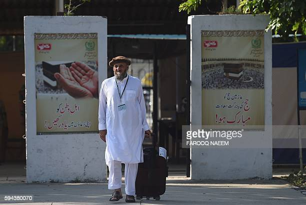 A Pakistani Hajj pilgrim arrives at The Hajj Complex in Islamabad on August 23 before leaving for the annual Hajj pilgrimage to the Islamic holy...