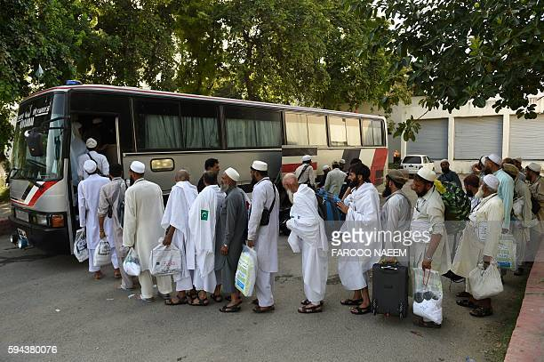 Pakistani Hajj pilgrims queut to embark onto a bus at The Hajj Complex in Islamabad on August 23 before leaving for the annual Hajj pilgrimage to the...