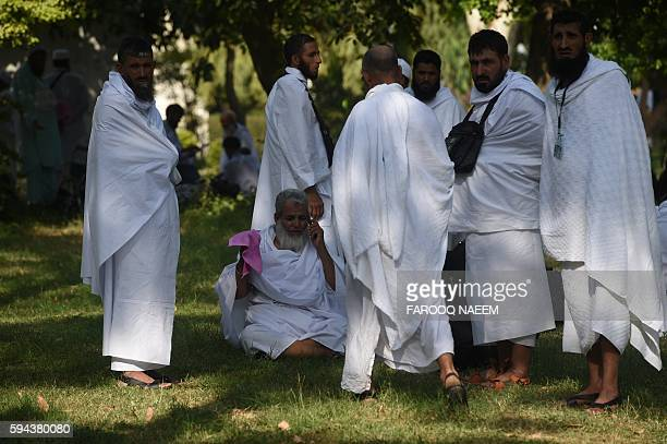 Pakistani Hajj pilgrims wait for transport at The Hajj Complex in Islamabad on August 23 before leaving for the annual Hajj pilgrimage to the Islamic...