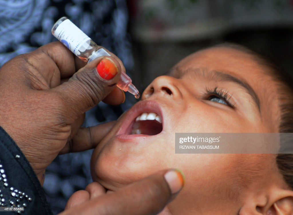 A Pakistani health worker administers polio drops to a child during a polio vaccination campaign in Karachi on January 20 2015 Pakistan is one of...