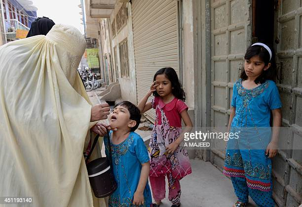 A Pakistani health worker administers the polio vaccine to a child during a vaccination campaign in Bannu on June 25 2014 Pakistan launched a fresh...