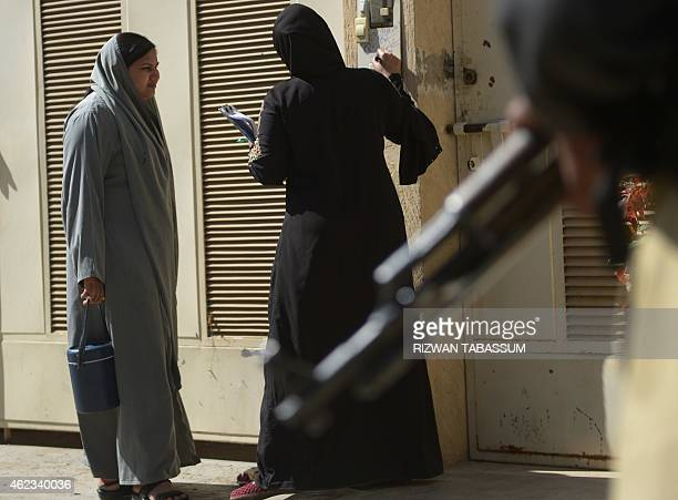 A Pakistani health worker marks a residence after vaccinating children during a polio vaccination campaign in Karachi on January 27 2015 Pakistan is...
